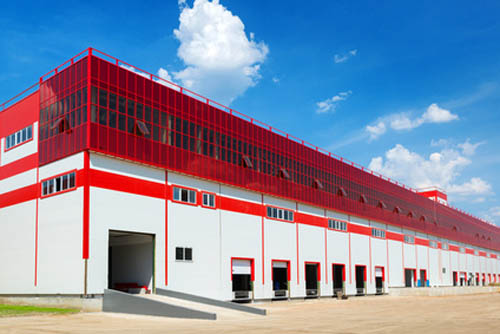 Warehouse On A Background Of Blue Sky