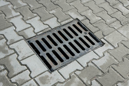 Sewer Manhole In The Pavement